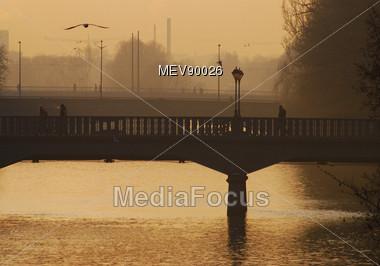 Bridge Over The River, Sunset, Isar, Munich Stock Photo