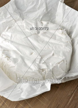 Brie Cheese On A Paper Packaging Stock Photo