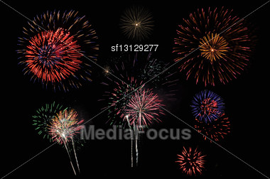 Bright And Colorful Fireworks Against A Black Night Sky Stock Photo