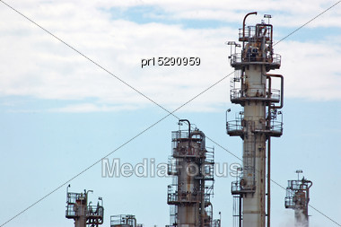 BRISBANE, AUSTRALIA, SEPTEMBER 28, 2008: Men Working At The Top Of A Tower At The BP Oil Refinery Near The Mouth Of The Brisbane River, September 28, 2008, Brisbane, Australia Stock Photo