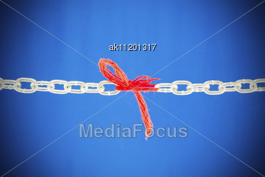 Broken Chain Connected With Red Threads Stock Photo
