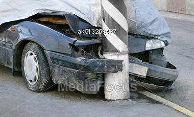 Broken Crashed Car On The Street Stock Photo