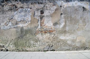 Broken Wall Near To Sidewalk Street In Old City Midday Stock Photo