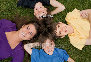 Brothers and Sister Smiling Stock Photo