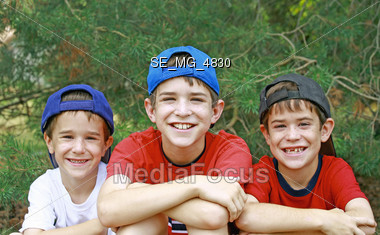 Brothers in Baseball Hats Stock Photo
