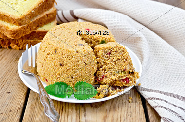 Brown Cheese Cooked In A Plate, Napkin, Fork, Bread, Mint On The Background Of Wooden Boards Stock Photo