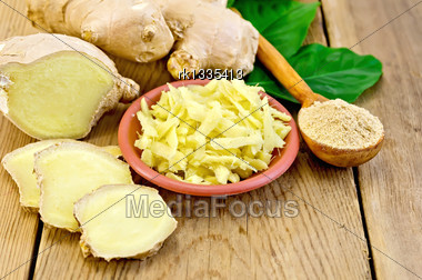 Brown Dish With Grated Ginger, A Wooden Spoon With Powder, Ginger Root, Green Leaves On The Wooden Board Stock Photo