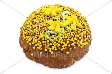 Brown Sandy Cake With Yellow And Green Decoration Of Sweets, Nuts Isolated Stock Photo