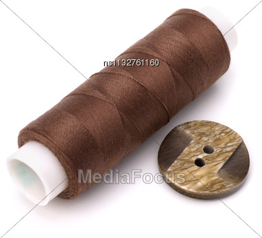 Brown Spool Of Thread Isolated On White Background Stock Photo