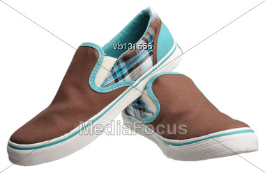 Brown Sport Shoes With White Soles, Isolated On A White Background Stock Photo