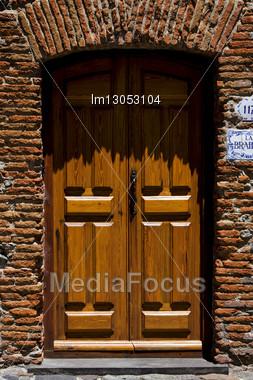 Brown Wood Old Door In The Centre Of Colonia Del Sacramento Uruguay Stock Photo
