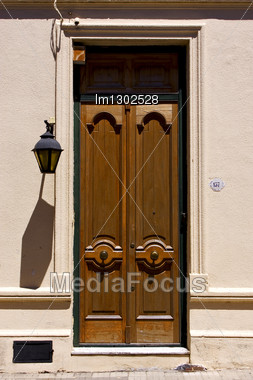 Brown Wood Old Door And A Street Lamp In The Centre Of Colonia Del Sacramento Uruguay Stock Photo