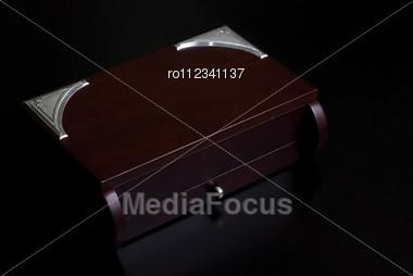 Brown Wooden Box On A Dark Background Stock Photo