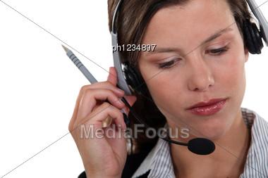 Brunette Call-center Worker Listening To Customer Stock Photo