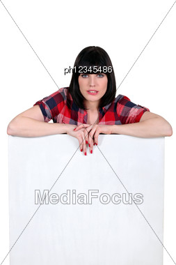 Brunette With Helmet Haircut Leaning On Board Stock Photo