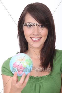 Brunette Holding Miniature Globe Stock Photo