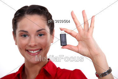 Brunette Holding USB Stick Stock Photo
