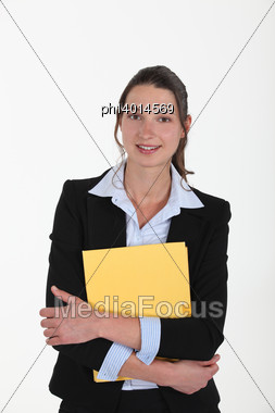 Brunette Holding Yellow Folder Stock Photo