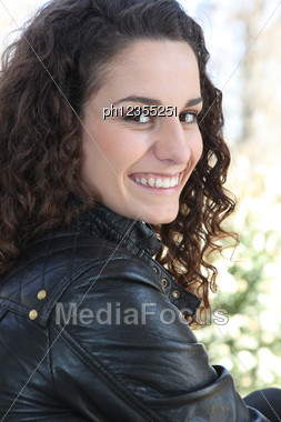 Brunette In Leather Jacket Stock Photo