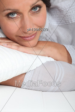 Brunette Lazing At Home Stock Photo