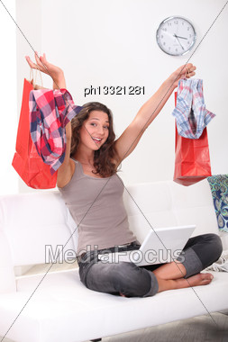 Brunette Shopping Online At Home Stock Photo