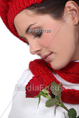 Brunette Smelling Rose Stock Photo