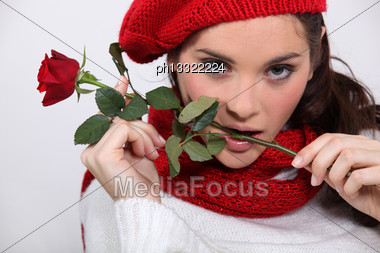 Brunette With Rose In Her Mouth Stock Photo