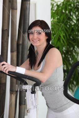 Brunette Woman Doing Fitness Stock Photo