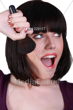 Brunette Woman With Makeup Brush Stock Photo
