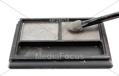 Brush On Eye Shadows In Black Container On White Background Isolated Stock Photo