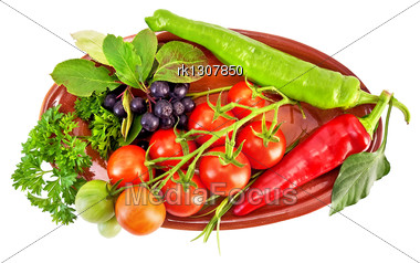 Brush Small Red Tomatoes, Two Cayenne, Brush Black Chokeberry With Leaves, A Sprig Of Parsley, Tarragon On A Ceramic Oval Plate Isolated Stock Photo