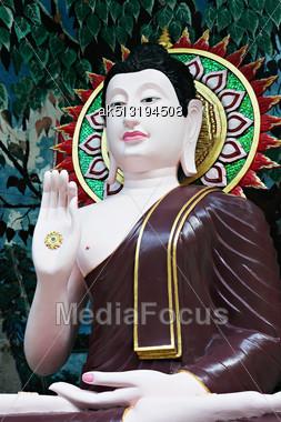 Buddha Statue On The Beauty Background Stock Photo