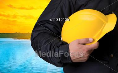 Builder On Beauty Sunset On Lake, And Orange Sky Stock Photo