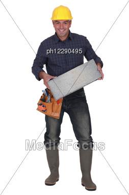 Builder Carrying Breeze Block Stock Photo