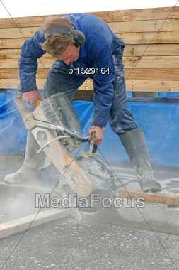 Builder Cuts Edge Of Concrete Slab With Diamond Saw Blade Concrete Cutter Stock Photo