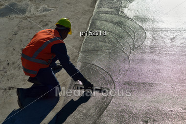 Builder Floating Off New Concrete For A Large Building Stock Photo