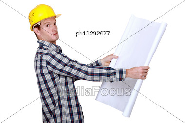 Builder Going Over Construction Plans Stock Photo