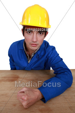 Builder Hitting Table With Fist Stock Photo