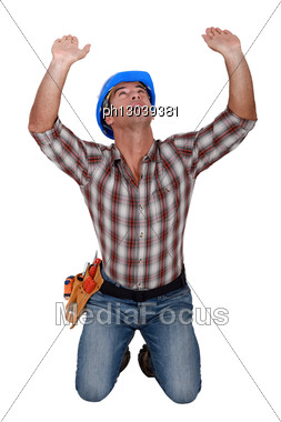 Builder Holding Up Invisible Object Stock Photo