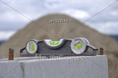 Builder's Level Left On Concrete Block Wall Stock Photo