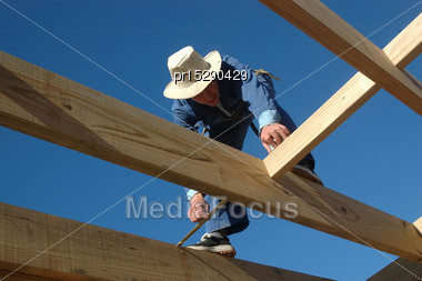 Builder Measures Up Spaces In Flooring Stock Photo