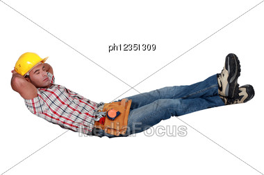 Builder Sleeping Stock Photo