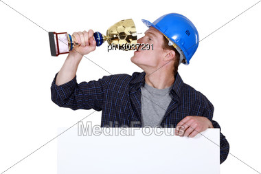 Builder With A Trophy Stock Photo