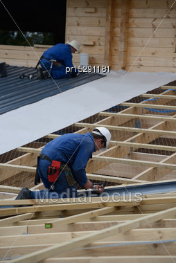 Builders Complete The Roofing Iron On A Major Construction Job Stock Photo