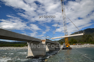 Builders Construct A Concrete Bridge Over A Small River In Westland, New Zealand Stock Photo