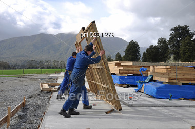 Builders Stand Up A Wall Framing Section On A Large Building Stock Photo