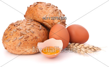 Bun With Seeds And Broken Egg Isolated On White Background Stock Photo