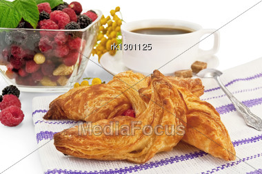 Bun In The Striped Napkin, Raspberries, Blackberries, Strawberries In A Glass Bowl, Coffee In A White Cup Stock Photo