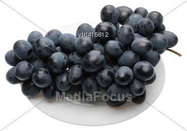 Bunch Of Black Grapes On A White Plate, Isolated Stock Photo