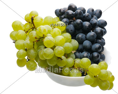 Bunches Of Black And Green Grapes In A White Cup On A White Background, Isolated Stock Photo